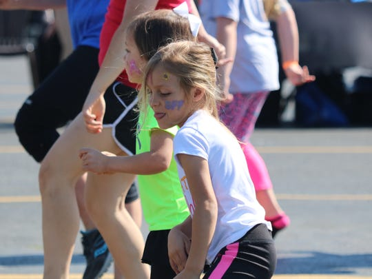 Madelyn Jobe concentrates on her next move during zumba.