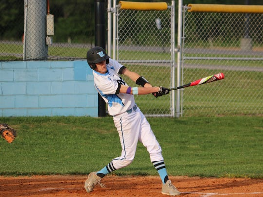 Josh Girten takes a swing at the ball Friday night
