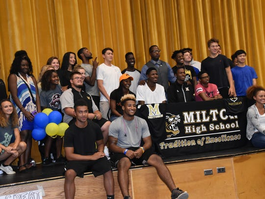 Members of the Milton High boys and girls track team help honor twin brothers Deionte and Jevonte Ganzy (North Iowa Area CC) and Brianna Washington (Florida A&M) who are getting chance further education and compete in college.