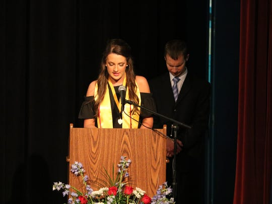 Ashley Duckworth, National Honor Society President begins the program with the invocation.