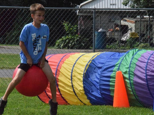 Isaiah Gibson bounces his way across the obstacle course.