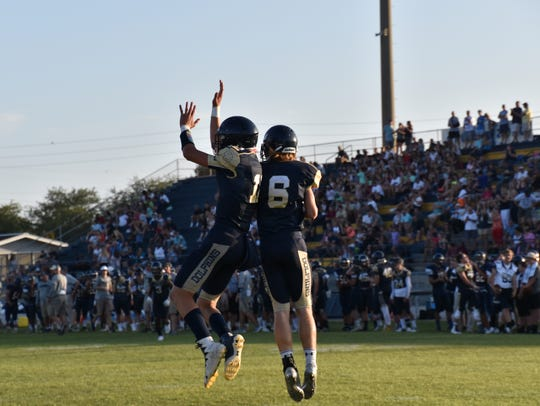 Gulf Breeze players celebrate touchdown during Friday