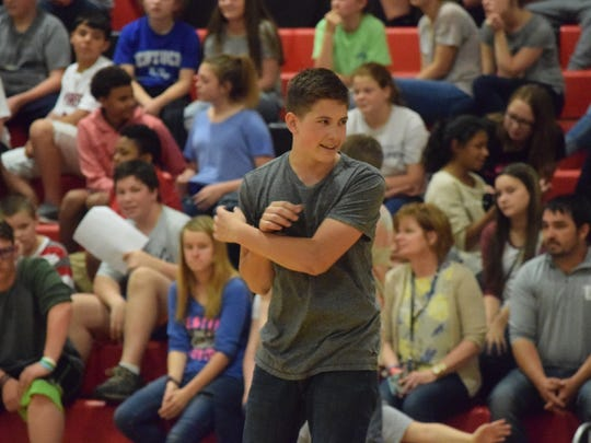 Reed Marple, eighth grader at UCMS, reacts during a competitive tribe war game.