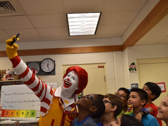 Ronald McDonald takes a selfie with Donna Treiser's fourth grade students at Big Cypress Elementary on May 24, 2017. The regional Ronald McDonald House Charities collected the 1,235,928 aluminum tabs that helps benefit the organization's sick children and their families.