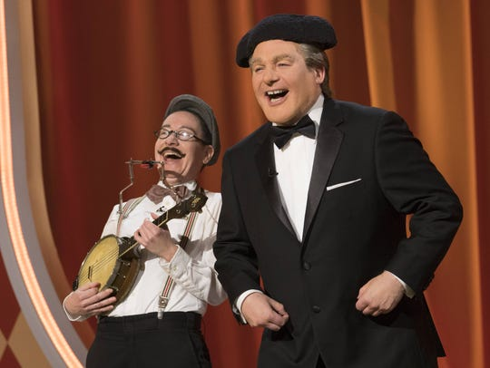 Host 'Tommy Maitland,' right, appears with a contestant