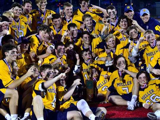 The Moeller Crusaders pose with their title.