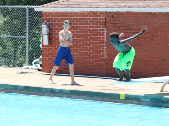 Abreyon Fletcher prepares for a dive into the Morganfield City Pool.