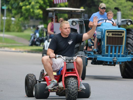 Dr. Jeremy Baker driving in the Sturgis Trade Days Parade on Saturday.