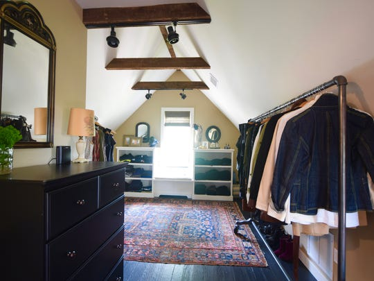 "The third-floor attic space — once an apartment — was revamped into an airy loft suite complete with master bath, and a dressing area/walk-in closet ""wing."""