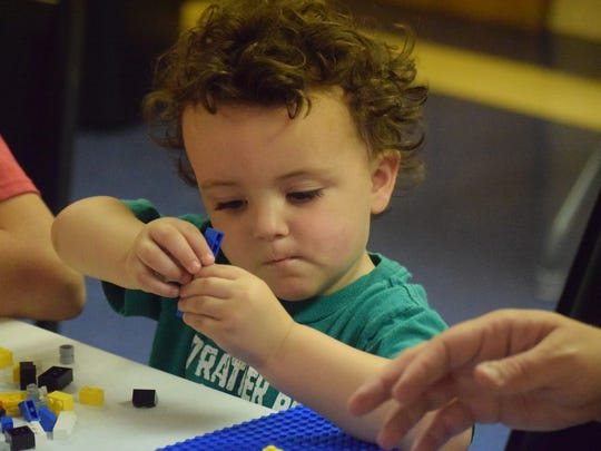 Blain Terrance studies his Legos intently as he works to build his tower.