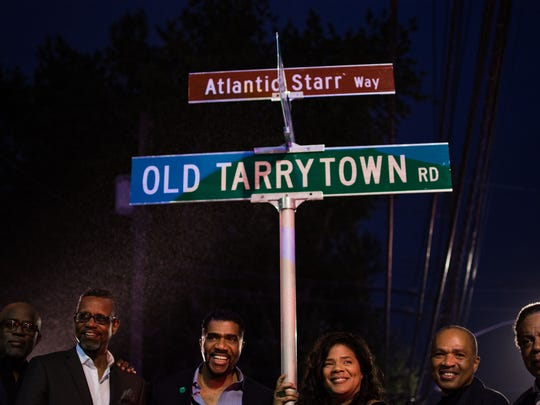 Old Tarrytown Road – between Knollwood Road and Hillside Avenue in Greenburgh, New York – was renamed Atlantic Starr Way. Six of the original nine members of Atlantic Starr – all Greenburgh natives are shown under the new street sign that bears the group's name. From left are Jonathan Lewis, Porter Carroll, Jr., Wayne Lewis, Sharon Bryant, David Lewis and Duke Jones.