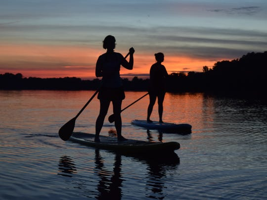 April Whitehead (left) and her sister Karen Waight, take a sunset stand-up paddle board trip around the Palmer Chapel Oxbow Marina in Pineville. Karen Waight and her husband James Waight recently started a business, River Paddle Rentals, LLC where they rent out paddle boards. They will deliver to locations in Pineville and Alexandria. Cost is $20 per hour and $10 per additional hours. All day rentals are $75. Delivery is $25. Each board comes with a leash, personal floatation device and paddle. Visit www.riverpaddlerentals.com for more information.