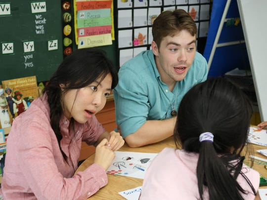 UVM graduating seniors Lily Kim and Ian Reilly teach Mandarin at Sustainability Academy on June 7, 2017.