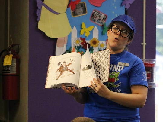 Christa Duke reads a story to the students during the
