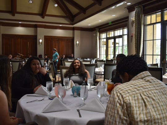 Area children enjoy free lunch hosted by David Harrison at The Players Club & Spa. Harrison has hosted the event for many years to make children in need feel special.
