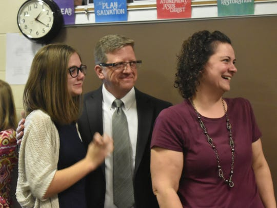 Daniel Woodward's family, sister Rebekah, left, parents George and Brenda, react to hearing where Woodard would be spending his two-year mission service for The Church of Jesus Christ of Latter-Day Saints. Woodward, a 2017 graduate of Rider High School, will be going to California in the fall.