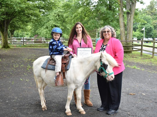 From left: Colin Joyce on Petie the Pony with his aunt,