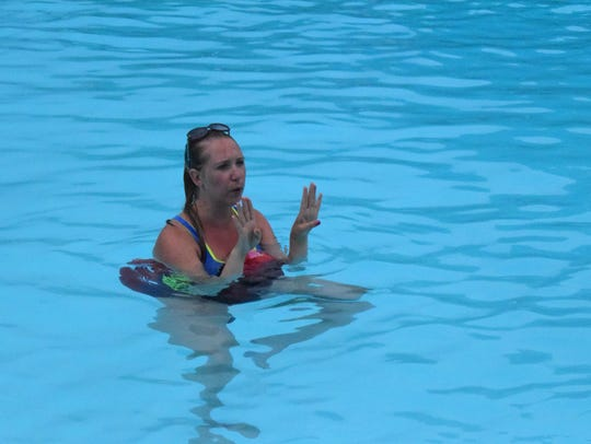 Katie Smith Abu-Khyarah stands in the pool in front