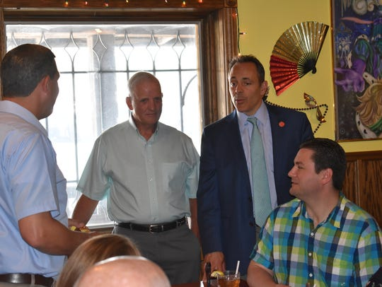 Gov. Bevin talks with folks gathered Wednesday including