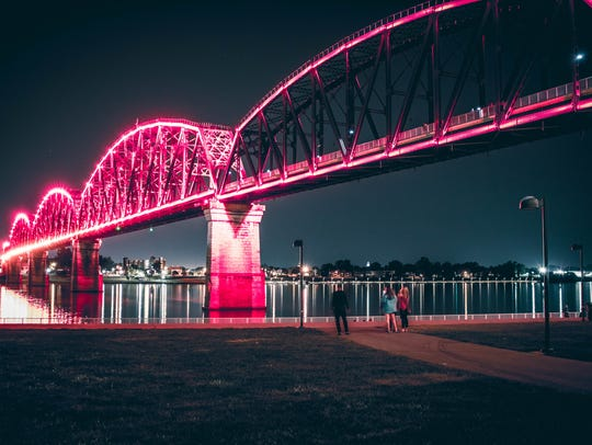 Big Four Bridge lit up at night in Louisville.