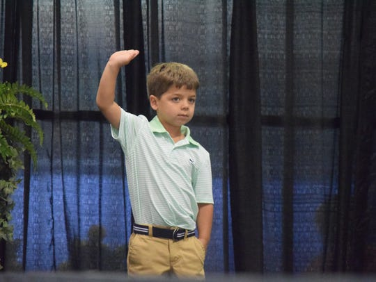 Buck Logan waves to the crowd during the Little Mr.