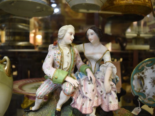 A 19th century French porcelain figurine of courtship