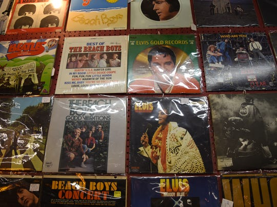 Vinyl records are sold at Treasure Island Antiques off of U.S. 41 in Naples. More than 40 vendors offer items such as jewelry, furniture, vinyl records, clothes, and porcelain figurines.
