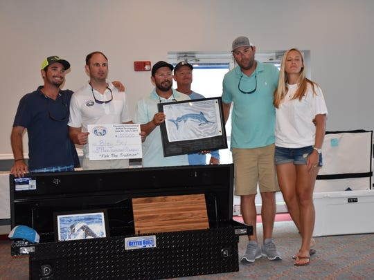 Several crew members of Bleu Sky with award as the