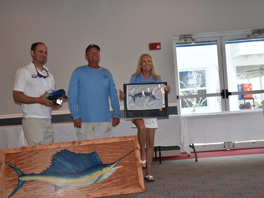 Lisa Foster with her award as Top Lady Angler, fishing
