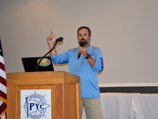 Tournament co-chairman Keith Johnson addresses the