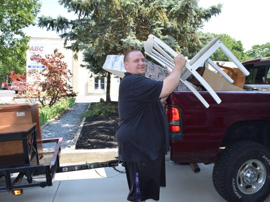 Nick Dobrowolski of Bridgeton delivers a truck load of furniture donations to Bethany Grace Community Church for the Cumberland County Housing First Collaborative. Photo/Jodi Streahle