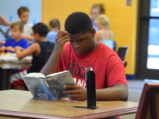 Darius Moore found a good book to read while attending