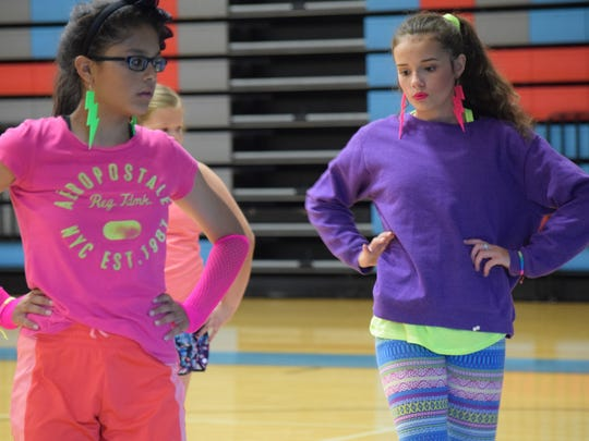 Sofia Ariza and ?? members of the UCHS Dance Team focus as they work to instruct several kiddos in their group.