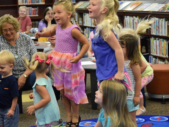 The kiddos participate in a dance-along song during Time for Tots.