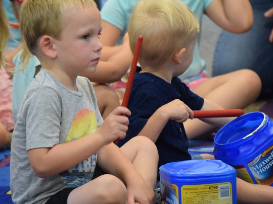 Jack White sits ready to play his drum at Time for Tots last Friday.