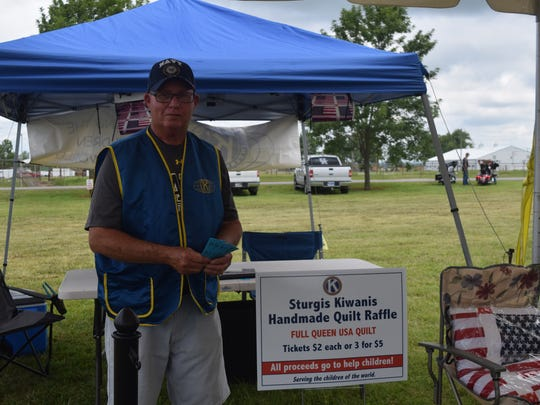Jim Brynes stands ready to assist guests and help sign them up for a raffle. The raffle, sponsored by the Sturgis Kiwanis Club, raffled off a handmade quilt.