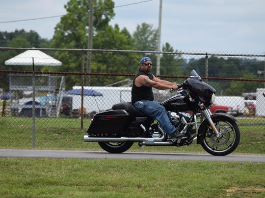 An out of town biker rides into check out the event.