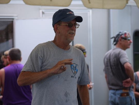 Jim Landrum, of the Blue Knights, helps direct guests