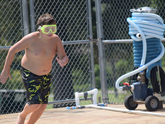 Paul Wolfe runs towards the swimming pool.