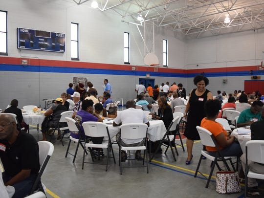 Residents gather at the Walker-Ford Community Center for a meeting about infrastructure improvement projects on Tallahassee's south side Saturday.