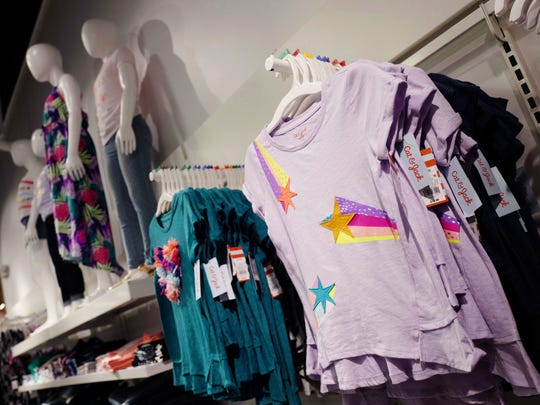 Cat & Jack tops for girls made with Repreve polyester fabric created from recycled plastic bottles are on display at a Target store, in New York. For this year's back-to-school shopping season, green is the new black. Increasingly, parents and their kids are looking for second-hand clothing or fashions made from reused material.