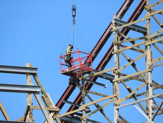 Construction crews continue to work a new roller coaster