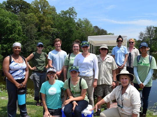 TNC Staff and interns take a boat ride down the Broadkill River from Milton to relax after a day of trail maintenance and to look for wildlife and see the McCabe Preserve from the water.