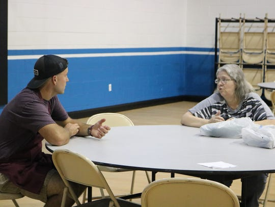 Eli Heriges talks with a guest at the soup kitchen