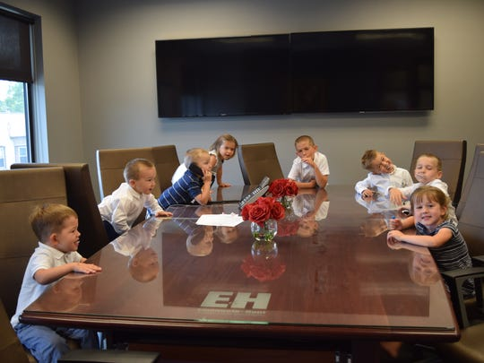 Attention future members of the board! Jane and Sam Emanuele's grandchildren take over the conference room at the accounting firm.