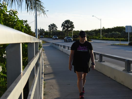 Annemarie Zoller, 28, of Naples, preps for this year's Susan G. Komen 3-day, 60-mile walk by walking around Marco Island. She's raising money and awareness for breast cancer by participating in the annual walk at the twin cities of Minneapolis and St. Paul in Minnesota this August.