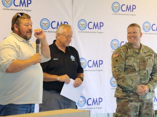 Mark Johnson, left, chief operating officer of the Civilian Marksmanship Program, thanks Capt. Michael Yates, right, base operations supervisor of Camp Perry, for all that the base does in hosting the National Matches each year.