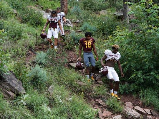 Arizona State football players make their way to the