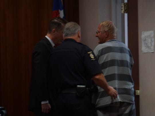 A court officer escorts Philip Stroupe Sr. out of the