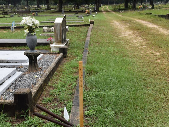 Small white flags and wooden stakes at the Milton Historic Cemetery on Thursday, Aug. 3, 2017, identify newly marked sections at the cemetery as part of the city's organization efforts.